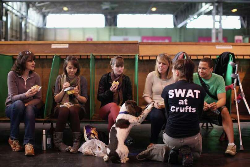 Dog owners relax over lunch on Day one of Crufts at the Birmingham NEC Arena on March 8, 2012 in Bir