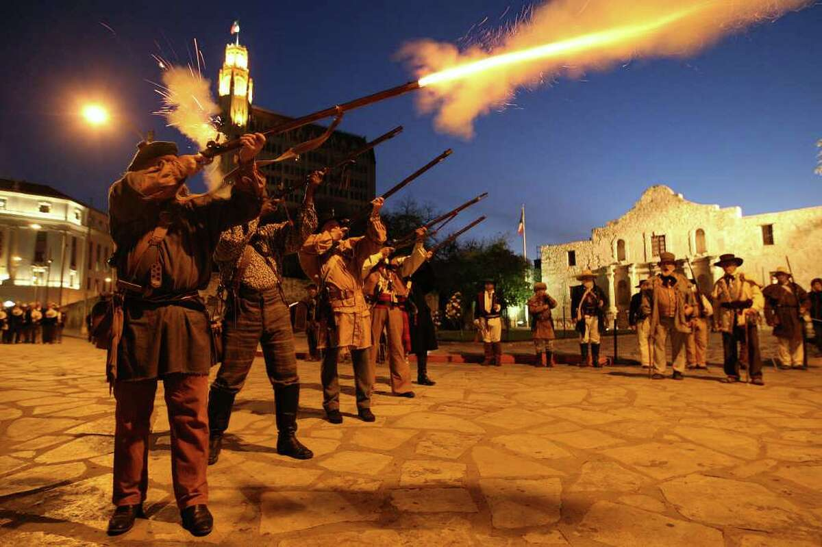 Members of the San Antonio Living History Association fire their flintlock muskets during the presentation of the 176th anniversary remembrance of the Battle of the Alamo at Alamo Plaza in San Antonio, Texas on Tuesday, March 6, 2012.