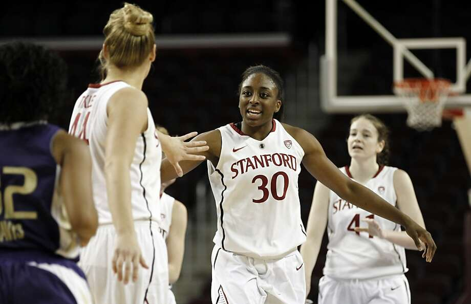 Stanford's Nnemkadi Ogwumike, center, Joslyn Tinkle, left, and Bonnie Samuelson celebrate during the second half of an NCAA college basketball game against Washington at the Pac-12 Conference tournament in Los Angeles, Thursday, March 8, 2012. Stanford won 76-57. (AP Photo/Matt Sayles) Photo: Matt Sayles, Associated Press