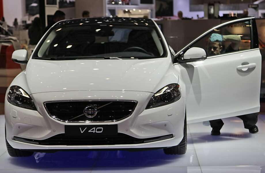 The Volvo V40 is on display on Wednesday, March 7, 2012 during the press preview days at the 82nd Geneva International Motor Show in Geneva, Switzerland.  The Motor Show will open it's doors to public from March 8 to 18, presenting more than 260 exhibitors and more than 180 world and European premieres. (AP Photo/Frank Augstein) Photo: Frank Augstein, Associated Press