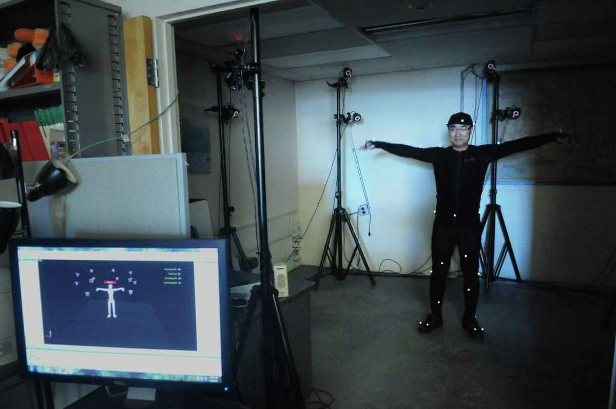 RPI doctoral student, Yiming Gao wears a motion capture suit in a room as an array of 12 3D motion capture cameras with infrared LEDs capture his movement which is seen on the computer screen at the RPI Nuclear Engineering Lab on Thursday, March 8, 2012 in Troy, NY. Members of the Rensselaer Radiation Measurement & Dosimetry Group have been working on the virtual reality and motion capture systems for use with radiation dose analysis. (Paul Buckowski / Times Union)