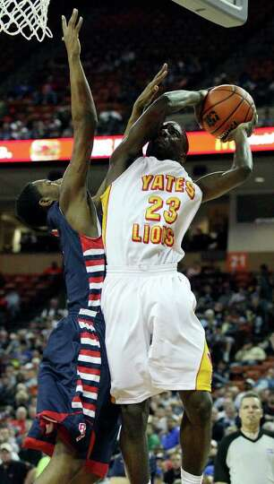FOR SPORTS - Houston Yates' Darrion Martin drives to the basket against Denton Ryan's Quincy Jones d