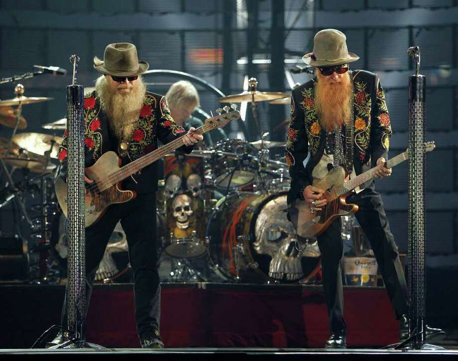 Dusty Hill Billy Gibbons Frank Beard with ZZ Top perform in concert during the Houston Livestock Show and Rodeo at Reliant Stadium Thursday, March 8, 2012, in Houston. ( James Nielsen / Chronicle ) Photo: James Nielsen / © 2011 Houston Chronicle