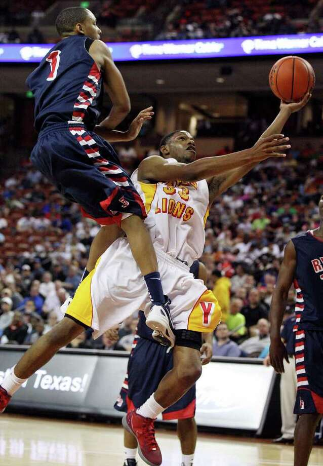 FOR SPORTS - Houston Yates' Chris Wells shoots around Denton Ryan's Gilbert Jackson during first half action of their Class 4A state semifinal game Thursday March 8, 2012 at the Frank Erwin Center in Austin, Tx. (PHOTO BY EDWARD A. ORNELAS/SAN ANTONIO EXPRESS-NEWS Photo: EDWARD A. ORNELAS, SAN ANTONIO EXPRESS-NEWS / © SAN ANTONIO EXPRESS-NEWS (NFS)
