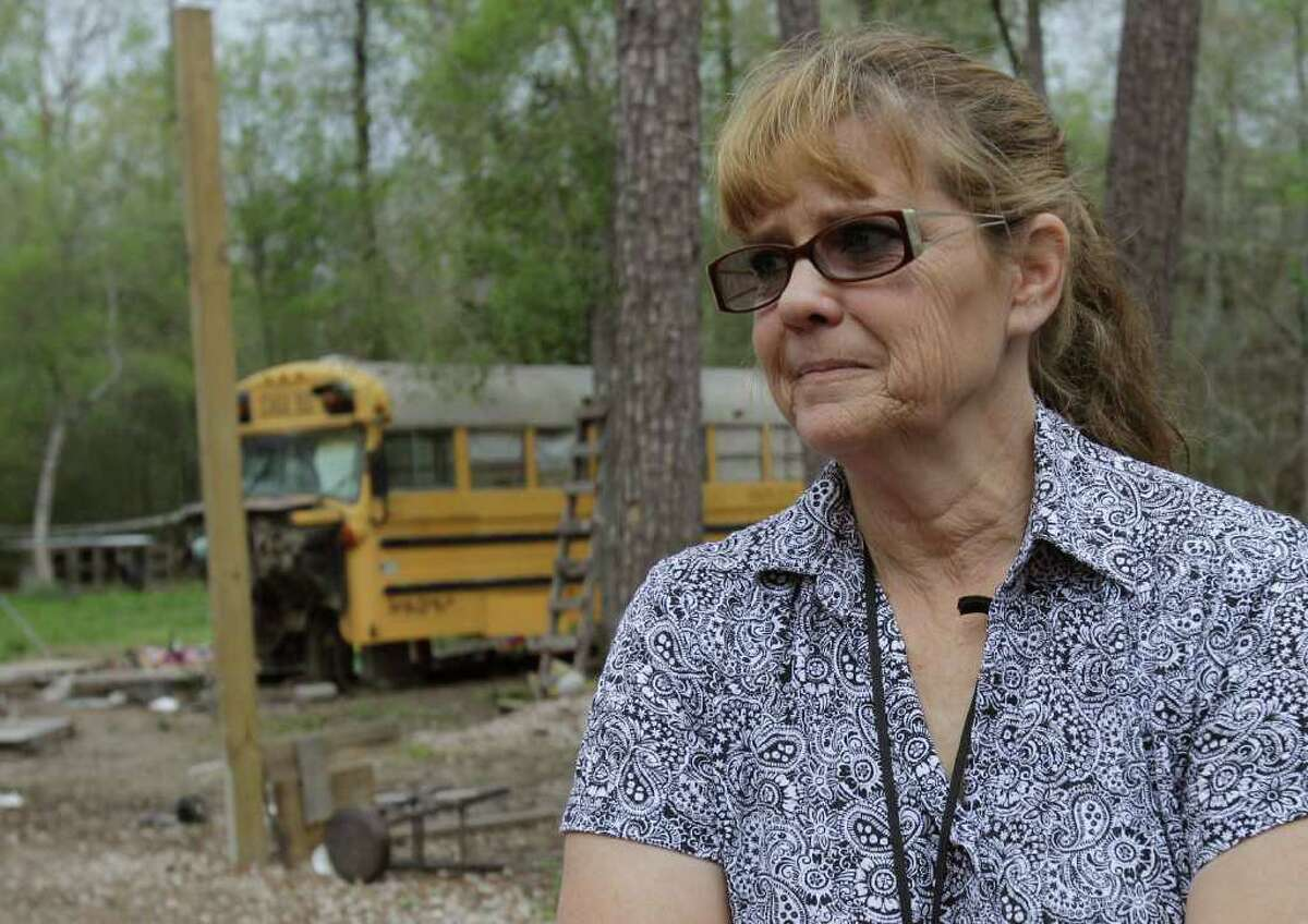 Postal carrier Vanessa Picazo stands Thursday outside the converted school bus in Splendora, where she discovered two children living. The siblings, ages 11 and 5, are now in the custody of child welfare authorities.