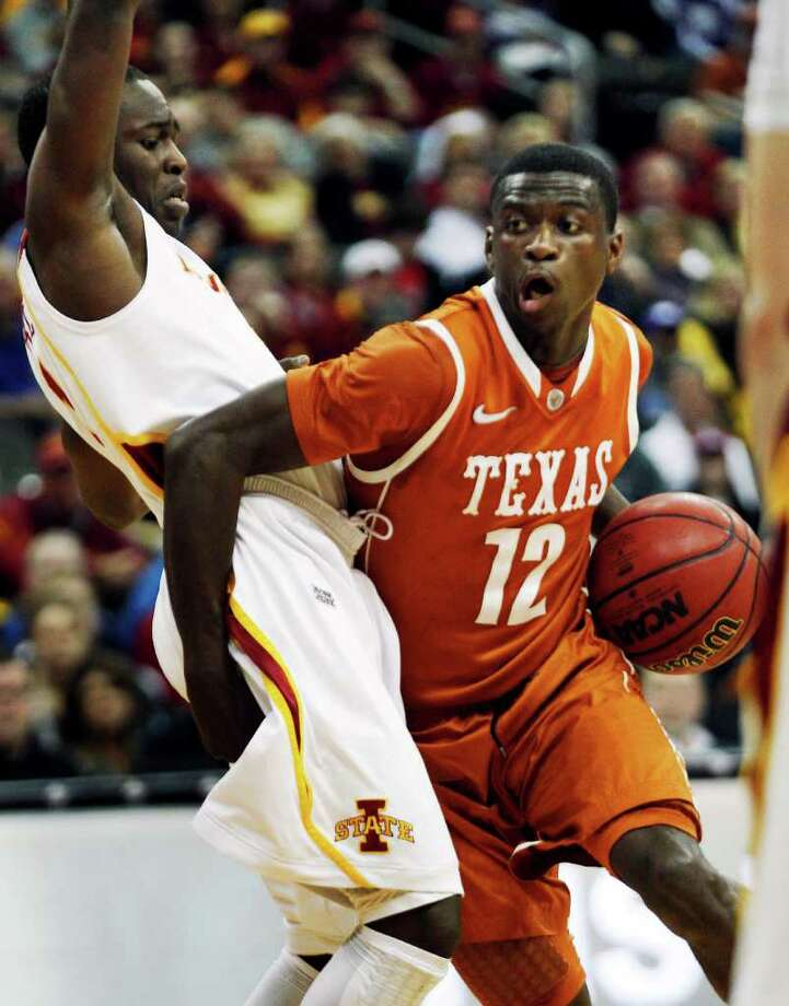 Texas guard Myck Kabongo (12) gets around Iowa State guard Bubu Palo (1) during the first half of an NCAA college basketball game in the Big 12 Basketball Tournament Thursday, March 8, 2012, in Kansas City, Mo. (AP Photo/Orlin Wagner) Photo: Orlin Wagner / AP
