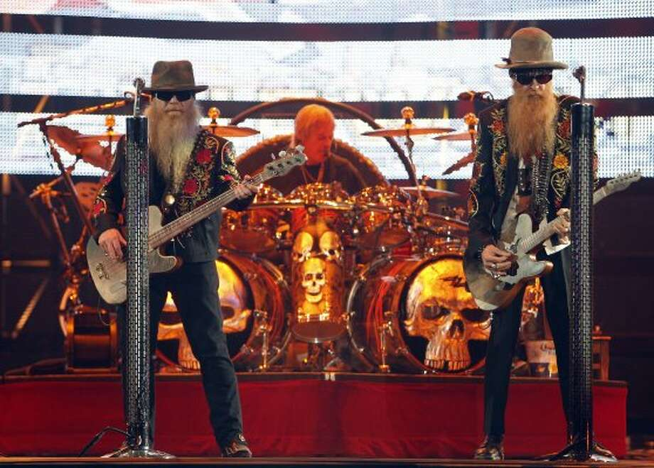 Dusty Hill, Billy Gibbons and Frank Beard with ZZ Top perform at the Houston Livestock Show and Rodeo on March 8. (James Nielsen / Chronicle)