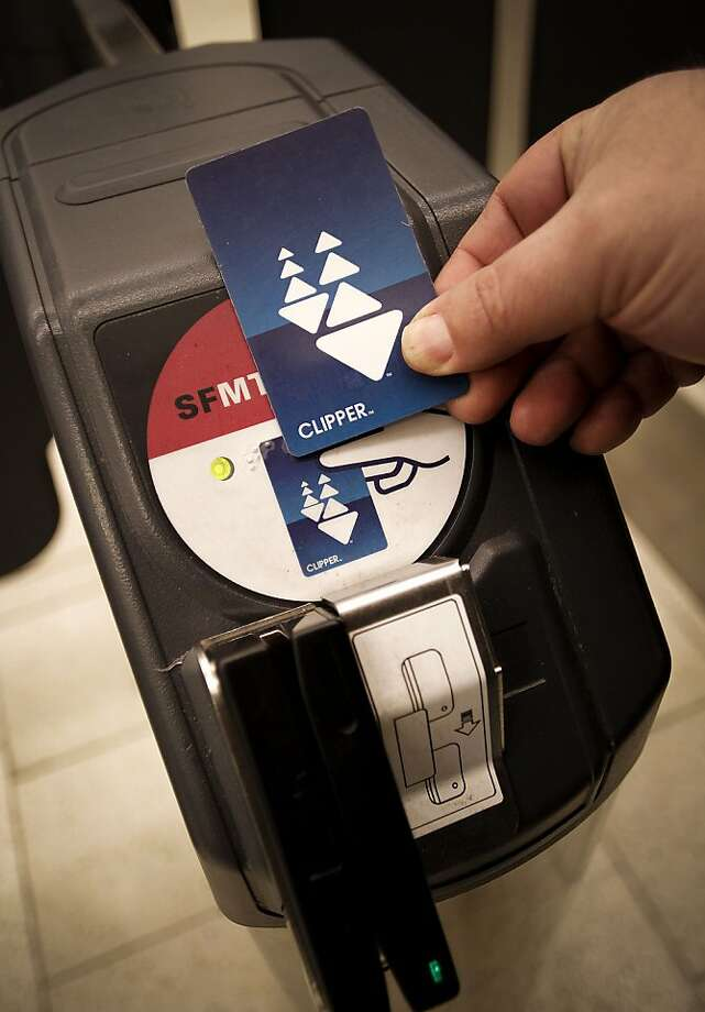 A passenger swipes the Clipper Card to access the MUNI station at the Powell Street BART station in San Francisco, Ca., on Thursday March 17, 2011. Use of the Clipper Card, the universal transit ticket, is soaring but there have been plenty of problems with the system. Photo: Michael Macor, The Chronicle