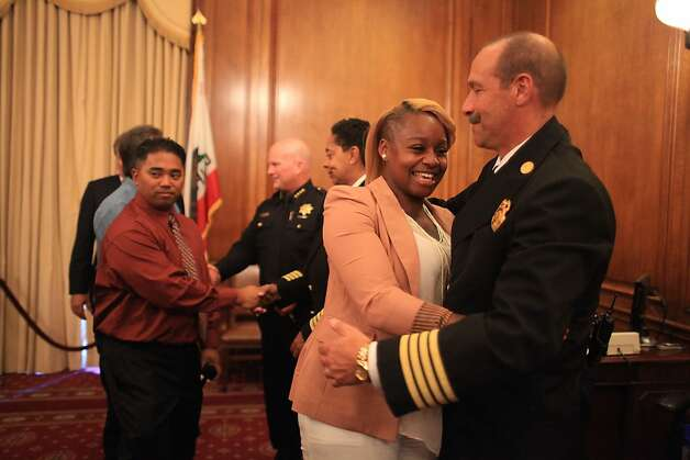 Keenia Williams (left) gets a hug from Tom Siragusa (left), SFFP deputy chief after a ceremony honoring her with the first Good Samaritan Award on Thursday, October 27, 2011 in San Francisco, Calif. Williams dragged Michael Finerty to safety after his big rig tipped over and burst into flames on Highway 101 in San Francisco on October 19, 2011. Photo: Lea Suzuki, The Chronicle