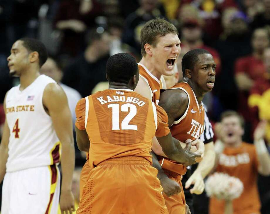 Clint Chapman (center) and Myck Kabongo show their appreciation for J'Covan Brown, whose three-point play late helped lift UT. Photo: Jamie Squire, Getty Images / 2012 Getty Images