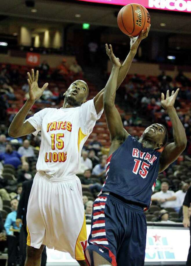 FOR SPORTS - Houston Yates' Maurice Ellis and  Denton Ryan's Sam Johnson grab for a rebound during second half action of their Class 4A state semifinal game Thursday March 8, 2012 at the Frank Erwin Center in Austin, Tx. Yates won 87-67. (PHOTO BY EDWARD A. ORNELAS/SAN ANTONIO EXPRESS-NEWS Photo: EDWARD A. ORNELAS, SAN ANTONIO EXPRESS-NEWS / © SAN ANTONIO EXPRESS-NEWS (NFS)