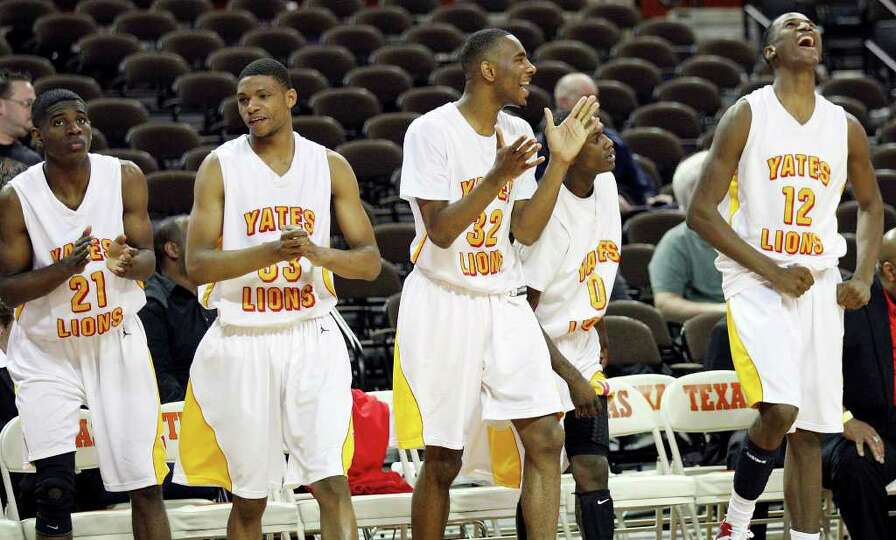 FOR SPORTS - Members of the Houston Yates basketball team celebrates after their Class 4A state semi