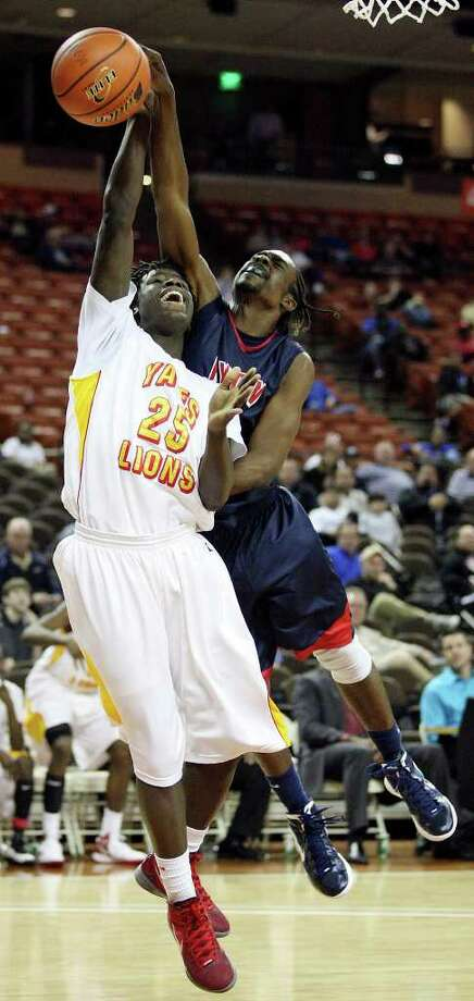 FOR SPORTS - Houston Yates' Ikenna Ozz is fouled by Denton Ryan's Trey Cook during second half action of their Class 4A state semifinal game Thursday March 8, 2012 at the Frank Erwin Center in Austin, Tx. Yates won 87-67. (PHOTO BY EDWARD A. ORNELAS/SAN ANTONIO EXPRESS-NEWS Photo: EDWARD A. ORNELAS, SAN ANTONIO EXPRESS-NEWS / © SAN ANTONIO EXPRESS-NEWS (NFS)