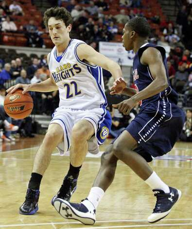 Alamo Heights' Jeffrey Rodewald looks for room around Dallas Kimball's Shannon Lilly Jr. during first half action of their Class 4A state semifinal game Thursday March 8, 2012 at the Frank Erwin Center in Austin, Tx. Photo: EDWARD A. ORNELAS, Express-News / © SAN ANTONIO EXPRESS-NEWS (NFS)