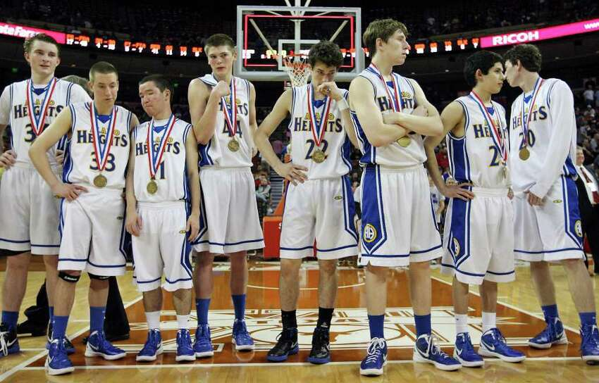 Members of the Alamo Heights basketball team stand on the court after their Class 4A state semifinal game with Dallas Kimball Thursday March 8, 2012 at the Frank Erwin Center in Austin, Tx. Kimball won 47-43. (PHOTO BY EDWARD A. ORNELAS/SAN ANTONIO EXPRESS-NEWS