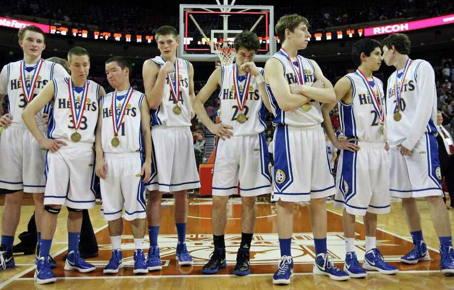 Members of the Alamo Heights basketball team stand on the court after their Class 4A state semifinal game with Dallas Kimball Thursday March 8, 2012 at the Frank Erwin Center in Austin, Tx. Kimball won 47-43. (PHOTO BY EDWARD A. ORNELAS/SAN ANTONIO EXPRESS-NEWS Photo: EDWARD A. ORNELAS, Express-News / © SAN ANTONIO EXPRESS-NEWS (NFS)