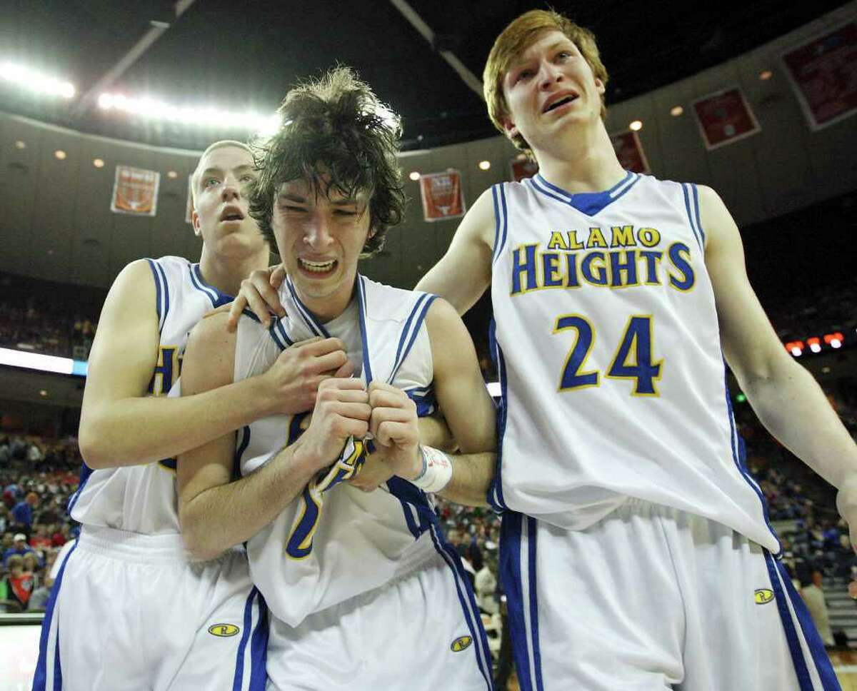 Alamo Heights' Jeffrey Mangold (from left), Dylan Lieck, and Sam Hazlewood are dejected after their Class 4A state semifinal game with Dallas Kimball Thursday March 8, 2012 at the Frank Erwin Center in Austin, Tx. Kimball won 47-43. (PHOTO BY EDWARD A. ORNELAS/SAN ANTONIO EXPRESS-NEWS