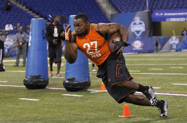 Utah State running back Robert Turbin runs a drill at the NFL football scouting combine in Indianapolis on Sunday, Feb. 26, 2012. (AP Photo/Dave Martin) Photo: Dave Martin, Associated Press