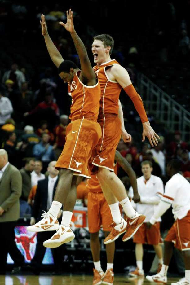 With Thursday night's win over Iowa State, Texas' Jaylen Bond, left, and Clint Chapman took a great leap forward in an attempt to make the school's 14th consecutive NCAA appearance. Photo: Orlin Wagner / AP
