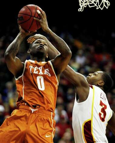 Texas guard Julien Lewis (0) shoots while covered by Iowa State forward Melvin Ejim (3) during the first half of an NCAA college basketball game in the Big 12 Conference tournament, Thursday, March 8, 2012, in Kansas City, Mo. (AP Photo/Orlin Wagner) Photo: Associated Press