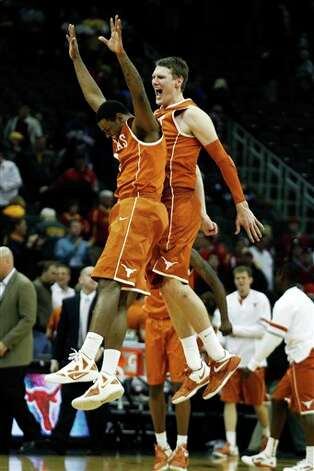 Texas forward Jaylen Bond (2) and center Clint Chapman (53) celebrate at the end of an NCAA college basketball game against Iowa State in the Big 12 Conference tournament, Thursday, March 8, 2012, in Kansas City, Mo. Texas won 71-65. (AP Photo/Orlin Wagner) Photo: Associated Press