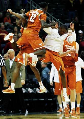 Texas guard Myck Kabongo (12) celebrates with teammates following an NCAA college basketball game against Iowa State in the Big 12 Conference tournament, Thursday, March 8, 2012, in Kansas City, Mo. Texas won 71-65. (AP Photo/Orlin Wagner) Photo: Associated Press