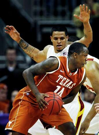 Texas guard J'Covan Brown (14) drives around Iowa State guard Chris Babb, rear, during the second half of an NCAA college basketball game in the Big 12 Conference tournament, Thursday, March 8, 2012, in Kansas City, Mo. Brown scored 23 points in the game as Texas won 71-65. (AP Photo/Orlin Wagner) Photo: Associated Press