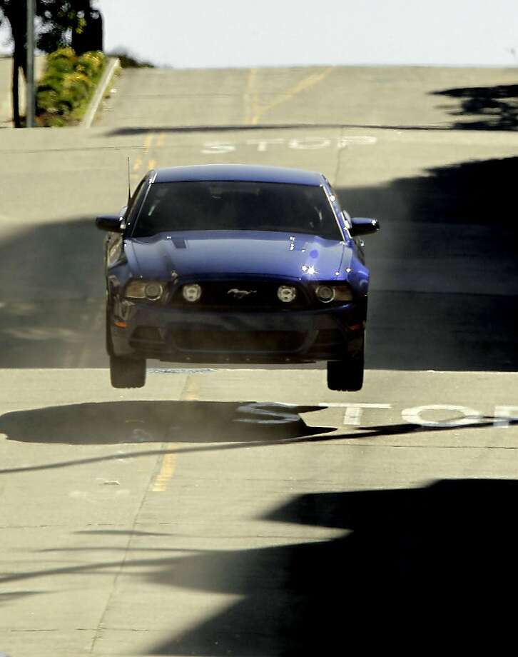 "The Ford Mustang goes airborn, as the chase scene is filmed along Taylor Street in San Francisco, Ca. on Tursday March 8, 2012. The Fox Broadcasting Company, television series , ""Alcatraz"" is filming a recreation of the famous chase scene from the 1968 classic film ""Bullit"" starring Steve McQueen, seen racing through the streets of San Francisco. Photo: Michael Macor, SFC"