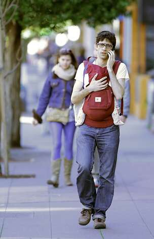 Nicholas Matsakis carries his daughter, Daphne down 24th Street in San Francisco, Calif., on Thursday, March 8, 2012. The San Francisco Board of Supervisors held a special committee hearing on family flight and why so many families with young kids are fleeing San Francisco at City Hall in San Francisco, Calif, on Thursday, March 8, 2012. Photo: Carlos Avila Gonzalez, The Chronicle