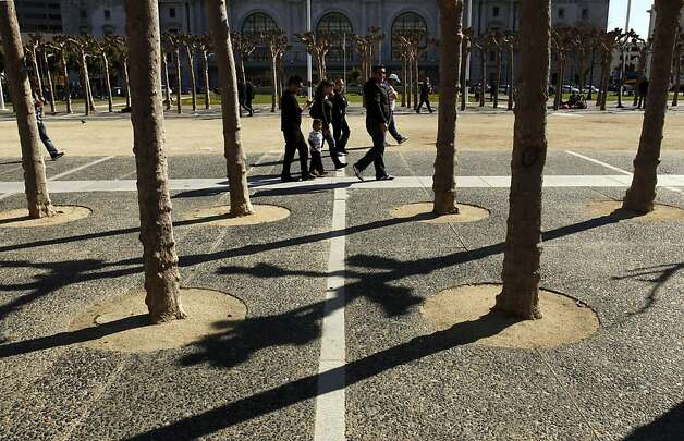 A family walks through Civic Center Plaza while inside City Hall, supervisors held a committee hearing on family flight from San Francisco. The San Francisco Board of Supervisors held a special committee hearing on family flight and why so many families with young kids are fleeing San Francisco at City Hall in San Francisco, Calif, on Thursday, March 8, 2012. Photo: Carlos Avila Gonzalez, The Chronicle