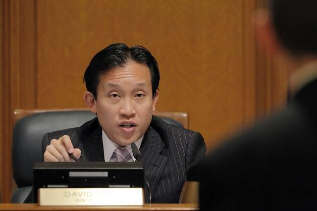 Supervisor David Chiu asks Chris Armentrout a question as he makes remarks before the SF Supervisors' committee hearing on family flight from San Francisco. The San Francisco Board of Supervisors held a special committee hearing on family flight and why so many families with young kids are fleeing San Francisco at City Hall in San Francisco, Calif, on Thursday, March 8, 2012. Photo: Carlos Avila Gonzalez, The Chronicle
