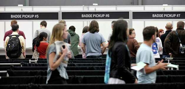 People form a line to pickup their South by Southwest badges on Thursday, March 8,  2012 at the Austin Convention Center. Photo: EDWARD A. ORNELAS, San Antonio Express-News / © SAN ANTONIO EXPRESS-NEWS (NFS)