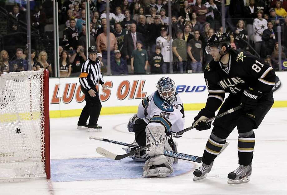 Dallas Stars center Tomas Vincour (81), of the Czech Republic, scores on a shootout against San Jose Sharks goalie Antti Niemi (31), of Finland, during an NHL hockey game on Thursday, March 8, 2012, in Dallas. The Stars won in overtime 4-3. (AP Photo/Tony Gutierrez) Photo: Tony Gutierrez, Associated Press