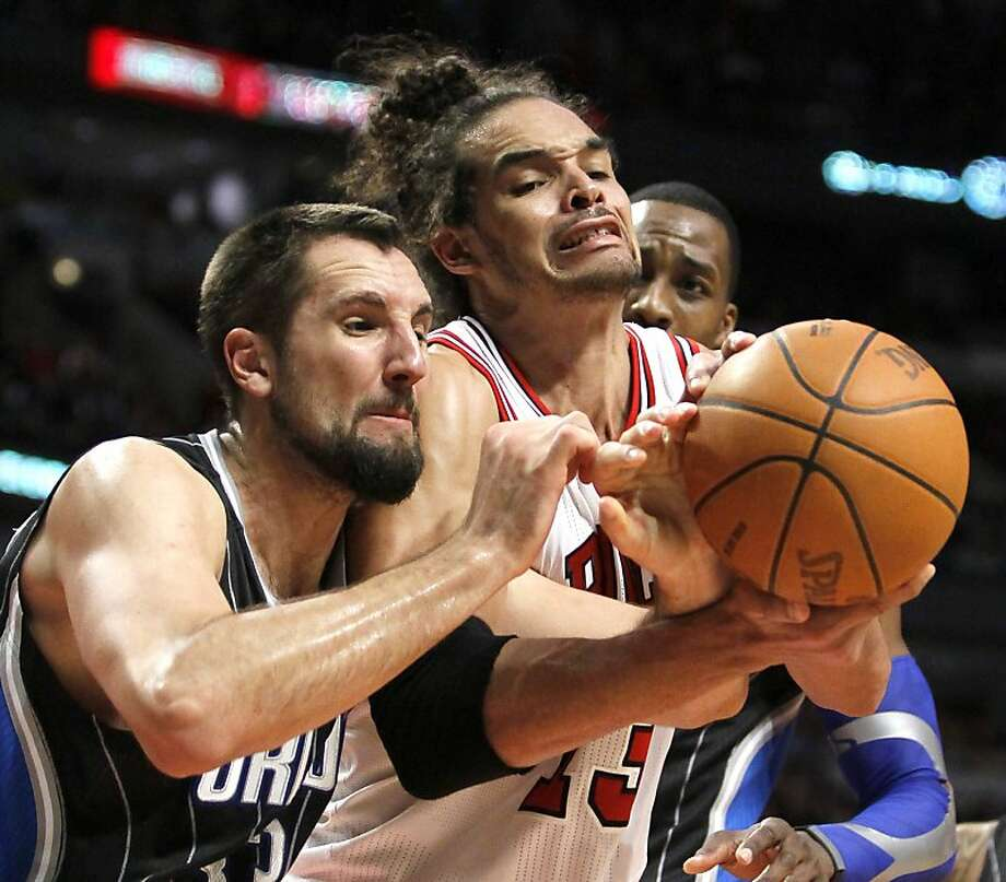 Orlando Magic forward Ryan Anderson, left, works against Chicago Bulls center Joakim Noah for a rebound during the second half of an NBA basketball game Thursday, March 8, 2012, in Chicago. The Magic won 99-94. Photo: Charles Rex Arbogast, Associated Press