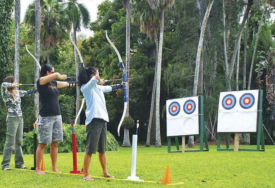 Certified instructors who are also longtime hotel employees now lead complimentary archery sessions on the lawn at Travaasa Hana, the former Hotel Hana-Maui. Photo: Travaasa Hana