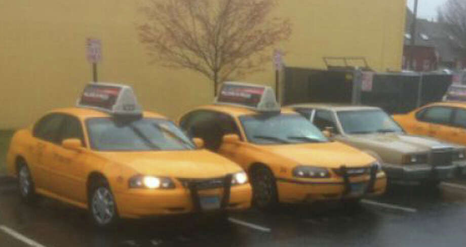 Yellow Cab and Red Dot taxi companies are competing for fares and the lease to operatre the dispatch center/waiting room at the Fairfield Railroad Station. Photo: File Photo / Fairfield Citizen