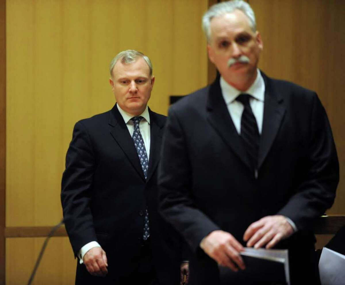William Jennings, left, and his attorney, Eugene Riccio, plead not-guilty to charges of second-degree assault, theft of services and second-degree intimidation based on race or bigotry at State Superior Court in Stamford, Conn., on Friday, March 9, 2012.
