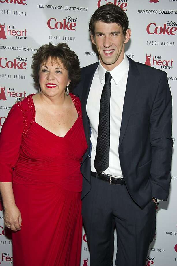 Michael Phelps and his mom Debbie Phelps attend the Heart Truth's Red Dress Collection during Fashion Week in New York, Wednesday, Feb. 8, 2012. (AP Photo/Charles Sykes) Photo: Charles Sykes, Associated Press