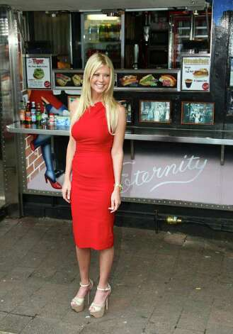 "Actress Tara Reid from the cast of the movie ""American Reunion"" poses for photos at the iconic Harry's Cafe de Wheels pie restaurant during a promotional event, Tuesday, March 6, 2012, in Sydney. (AP Photo/Rick Rycroft) Photo: Rick Rycroft, STF"