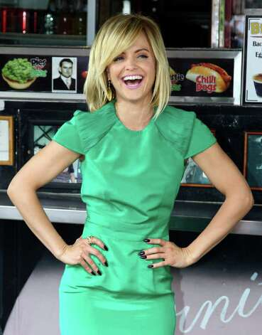"Actress Mena Suvari from the cast of the movie ""American Reunion"" poses for photos at the iconic Harry's Cafe de Wheels pie restaurant during a promotional event, Tuesday, March 6, 2012, in Sydney. (AP Photo/Rick Rycroft) Photo: Rick Rycroft, STF"