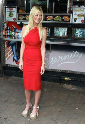 "Actress Tara Reid from the cast of the movie ""American Reunion"" poses for photos at the iconic Harry's Cafe de Wheels pie restaurant during a promotional event for the film, Tuesday, March 6, 2012, in Sydney. (AP Photo/Rick Rycroft) Photo: Rick Rycroft, STF"