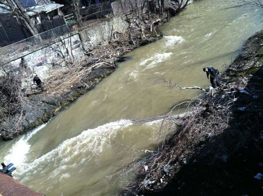 Divers searched the canal near 2nd Street for evidence in the Sha-Kim Miller shooting Friday morning, March 9, 2012, in Troy, N.Y. (Michael P. Farrell / Times Union)