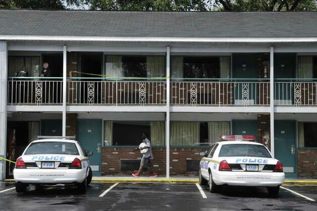 Colonie Police at the scene on the second floor  of a murder at the Super 8 Motel on Central Ave. on Sunday, Aug. 21, 2011 in Colonie, NY.   (Paul Buckowski / Times Union archive) Photo: Paul Buckowski