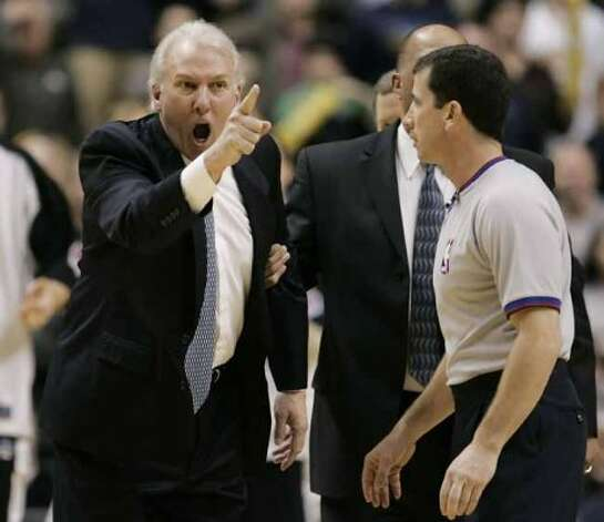San Antonio Spurs coach Gregg Popovich, left, argues a call with official Tim Donaghy during the fourth quarte of an NBA basketball game against the Indiana Pacers in Indianapolis, Sunday, Feb. 12, 2006. San Antonio defeated Indiana 92-88. (AP Photo/Darron Cummings) (ASSOCIATED PRESS)