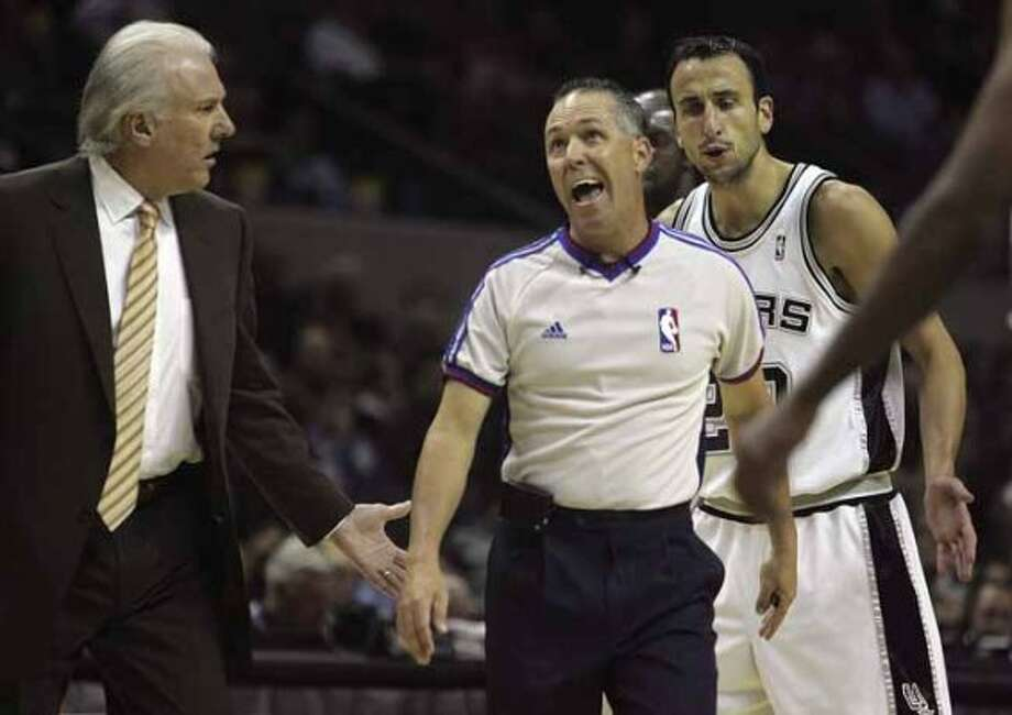 SPORTS - Greg Popovich and Manu Ginobili question a cal by ref Jason Phillips in the first half Wednesday, November 7, 2007 at the AT&T Center. BAHRAM MARK SOBHANI/STAFF (SAN ANTONIO EXPRESS NEWS)