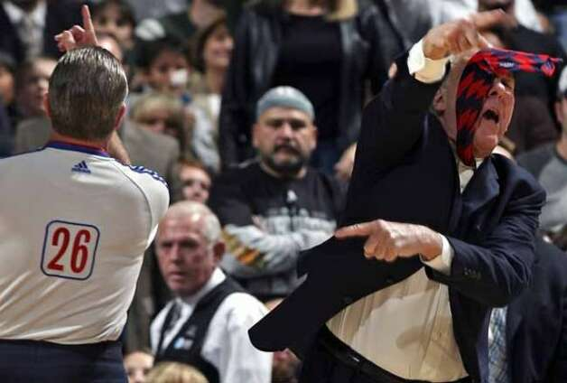 SPORTS    Spurs coach Greg Popovich gestures wildly as he gets tossed out of the game against Toronto by referee Bob Delaney. San Antonio Spurs versus the Toronto Raptors at the AT&T Center in San Antonio, December 28, 2007.      Tom Reel/Staff   December 28, 2007. (SAN ANTONIO EXPRESS-NEWS)
