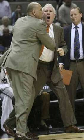 SPTS- Spurs Greg Popovich argues with officials as assistnat Don Newman holds him back and then he is ejected in the 2nd period of play against theIndiana Pacersat the at&t center Thursday March 6 (SAN ANTONIO EXPRESS NEWS)