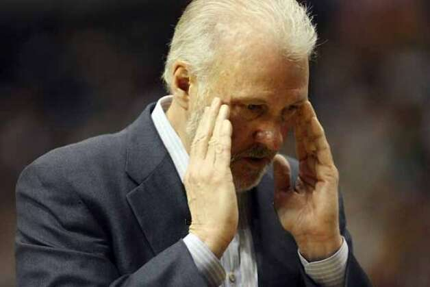 FOR SPORTS - Spurs' headcoach Gregg Popovich walks along the bench during first half action of Game 4 in the First Round of the Western Conference Playoffs against the Mavericks Saturday April 25, 2009 at the American Airlines Center in Dallas, Tx. (PHOTO BY EDWARD A. ORNELAS/eaornelas@express-news.net) (SAN ANTONIO EXPRESS-NEWS)