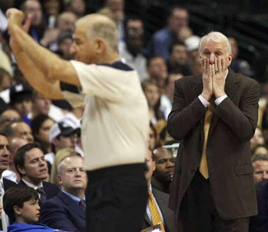 FOR  SPORTS - Spurs' headcoach Gregg Popovich reacts after a foul was called on Spurs' Keith Bogans during second half action  of Game 1 of the first round of the Western Conference playoffs against the Mavericks Sunday April 18, 2010 at the American Airlines Center in Dallas, Tx. The Mavericks won 100-94. (PHOTO BY EDWARD A. ORNELAS/eaornelas@express-news.net) (SAN ANTONIO EXPRESS-NEWS)