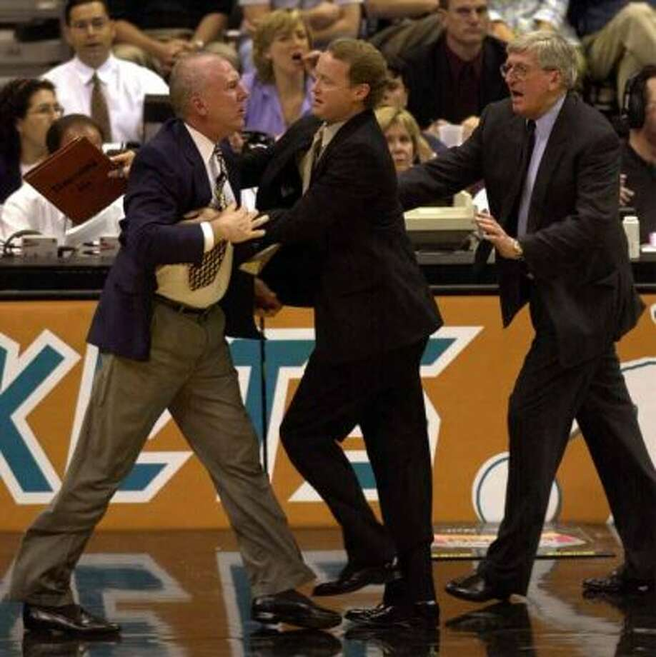 Spurs head coach Gregg Popovich is restrianed by assistant coach Mike Budenholzer and Hank Egan after Popovich protested a flagrant foul call on Danny Ferry at the Alamodome on Monday, May 7, 2001. Popovich received a douvle technical and was ejected in the 2nd quarter.   Kin Man Hui/staff. (San Antonio Express-News)